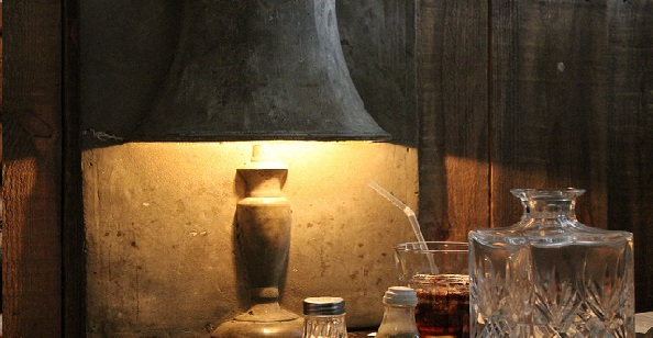 A quirky cement lamp and the crystal water decanter at Lucky 7 Canteen