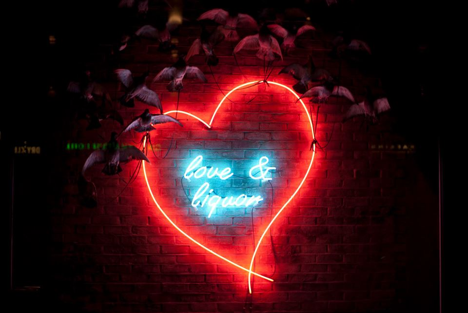 A 'Love and Liquor' sign welcomes you to the club.